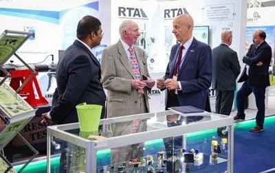 Barnbrook Systems managing director Tony Barnett, centre, at the Farnborough International Air Show